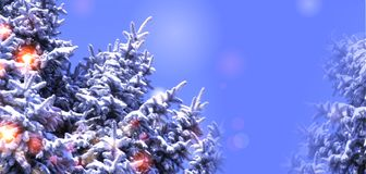 Winter tree with lights on the background of blue sky Stock Images