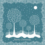 Winter trees on Christmas postcard background. Stock Photo