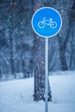 Winter trees with road sign. Picture of winter day with trees with road sign of bicycle path in frost Stock Photo