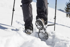 Winter trekking with male boots in the snow Royalty Free Stock Photos