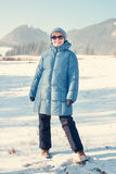 Winter trip. Woman posing on a mountains background Royalty Free Stock Image