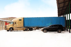 Winter truck. Truuk stands near the warehouses, at uploading. photography, retouching Royalty Free Stock Photo