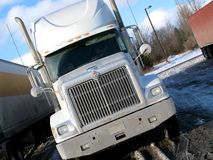 Winter Truck. A salt-encrusted truck stands at a rest area in North America in winter stock image
