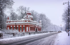 Winter in Tsarskoye Selo. Brick Pavilion in Tsarskoye Selo and trees in the snow Royalty Free Stock Photography
