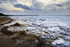 Winter twilight on a frozen shore. Royalty Free Stock Photos