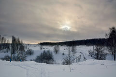 Winter twilight landscape. Winter landscapes with a ravine in the background of the setting sun Royalty Free Stock Photo