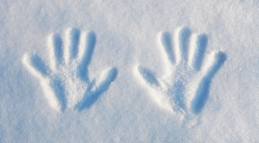 Winter -  two handprints in the snow. Royalty Free Stock Image