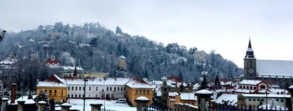 Winter.  Typical urban landscape of the city Brasov, Transylvania Brasov is a town situated in Transylvania, Romania, in Royalty Free Stock Photos
