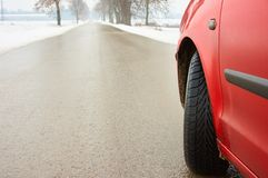 Winter tyre. On asphalt road Royalty Free Stock Photos