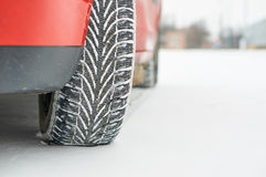 Winter tyre. New winter tyre on red car Stock Photo
