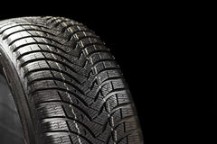 Free Winter Tyre On Black Stock Images - 28542064