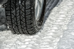 Winter tyre on the road Royalty Free Stock Image