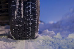 Winter tyre on the road. With snow Royalty Free Stock Photo