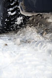 Winter tyre on snow Stock Photos