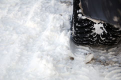 Winter tyre on snow Stock Image