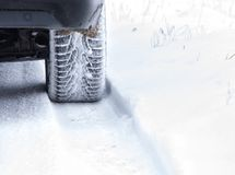 Winter Tyre on snowy country road. royalty free stock photo
