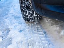 Winter tyre with tracks close up shot on the snow stock photography