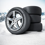 Winter tyres standing on snow. 3D illustration.  Stock Photos