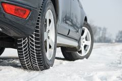 Winter tyres wheels installed on suv car outdoors. Car with winter tyres installed on light alloy wheels in snowy outdoors road royalty free stock images