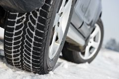 Winter tyres wheels installed on suv car outdoors. Car with winter tyres installed on light alloy wheels in snowy outdoors road stock images