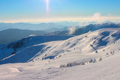 Winter, ukraine, mountain, sunset, carpathian , mountain range ,landscapes ,tourism ,snow journey ,outdoors    ,sky ,fog ,clouds Royalty Free Stock Images