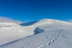 Winter, ukraine, mountain, sunset, carpathian , mountain range ,landscapes ,tourism ,snow journey ,outdoors    ,sky ,fog ,clouds Stock Photography