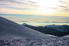 Winter, ukraine, mountain, sunset, carpathian , mountain range ,landscapes ,tourism ,snow journey ,outdoors    ,sky ,fog ,clouds. Winter in the mountains Stock Image