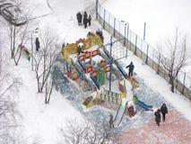 Winter, urban courtyard, children playground, people royalty free stock photo