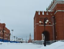 Winter urban landscape with snow from buildings and Orthodox Church
