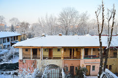 Winter urban scenery. Old house in pastel colors Stock Images