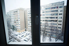 Winter urban view through a window Royalty Free Stock Photo
