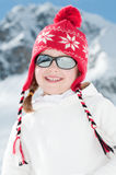 Winter vacation. Little girl in winter resort Stock Photography