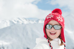 Winter vacation. Little girl in winter resort Stock Image