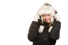 Winter vacation. Cheerful girl in warm clothes. Stock Photos