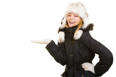 Winter vacation. Cheerful girl in warm clothes. Stock Image