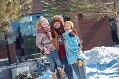 Winter vacation. Family time together outdoors father holding daughter up laughing happy royalty free stock photo