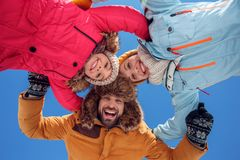 Winter vacation. Family time together outdoors hugging looking camera smiling excited bottom view stock image