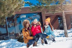 Winter vacation. Family time together outdoors sitting with thermos drinking hot tea smiling joyful stock photos