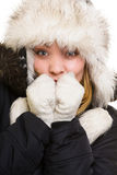 Winter vacation. Freezing girl warming her hands. Stock Photo