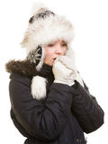 Winter vacation. Freezing girl warming her hands. Royalty Free Stock Images
