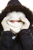 Winter vacation. Girl covering face with scarf. Royalty Free Stock Images