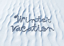 Winter vacation, words on snow Royalty Free Stock Photos