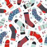 Winter vector seamless pattern with knitted socks, berries and s stock illustration