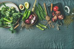 Winter vegetarian food cooking ingredients, grey linen background, copy space Royalty Free Stock Photo