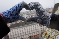 Two female hands make a heart sign. Winter Vienna. View from above royalty free stock photography