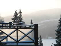 Winter view of the balcony of the house and the ski slope.  royalty free stock photos