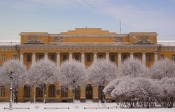 Winter view of Barracks of Pavlovsky life guard regiment also known as Lenenergo building through the trees covered with snow. The field of Mars architectural Royalty Free Stock Photo