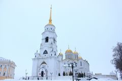 Winter view of the Belltower of the Assumption Cathedral in the city Vladimir Russia from the cathedral square in the cloudy day Stock Photo