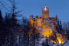 Winter view of Bran castle Stock Images