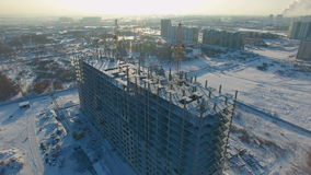 Winter view of a building under construction. stock video footage